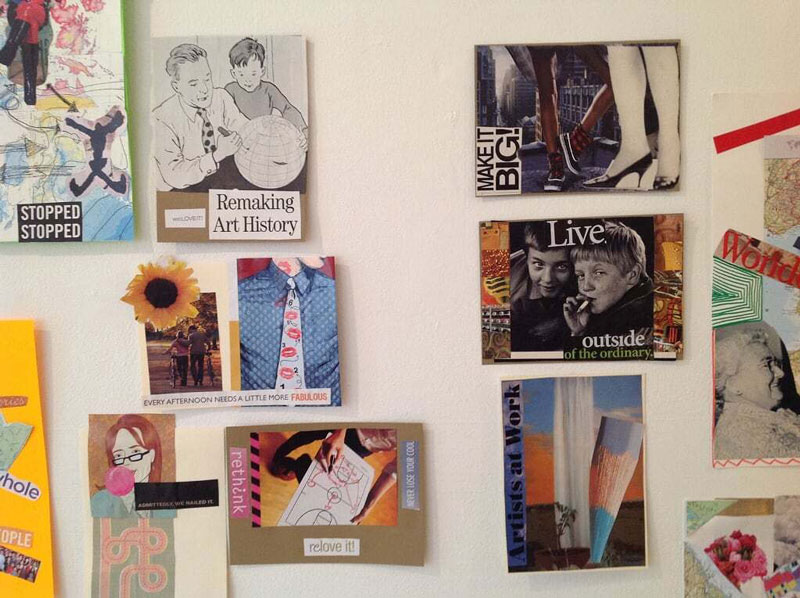 A white wall covered in art collages